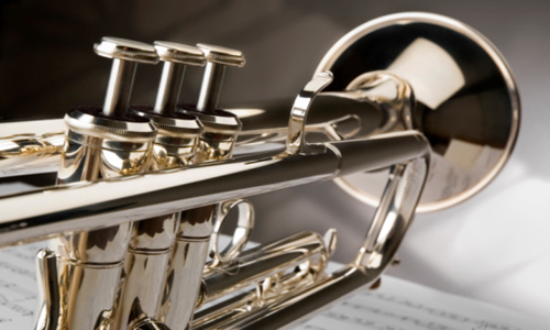 A polished trumpet with sheet music