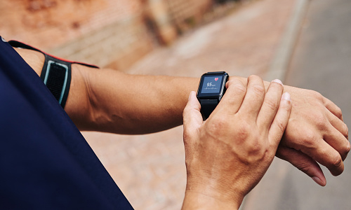 Jogger checking pulse on smartwatch
