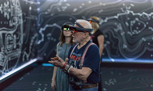 Erisa Hines of JPL and Apollo 11 astronaut Buzz Aldrin wearing HoloLens mixed-reality headsets