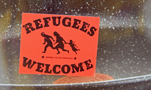 Refugees welcome stick on car window