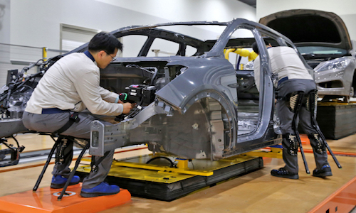 Staff work wearing the automaker's Hyundai Chairless Exoskeleton assistive robot