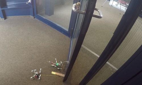 tiny drones opening a door