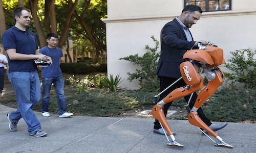Professor Aaron Ames walks on campus alongside Cassie, a semi-autonomous robot.