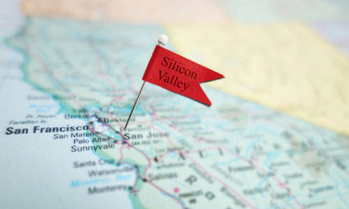 "A flag that has the words ""Silicon Valley"" pinned on a map"