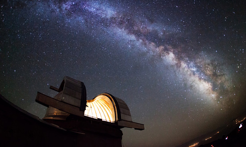 Astronomical observatory under stars