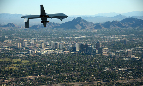 Unmanned aircraft flying above city
