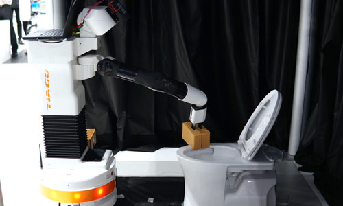 A robot cleaning the toilet