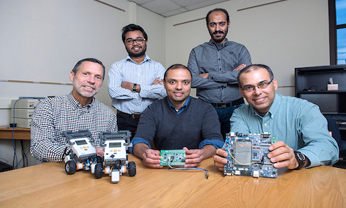A Purdue University team displays hardware related to research to improve cybersecurity for large-scale systems.