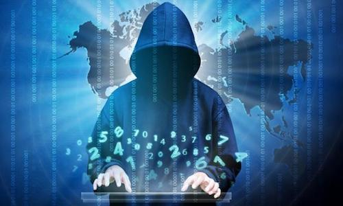 An illustration of a cybercriminal at a computer.