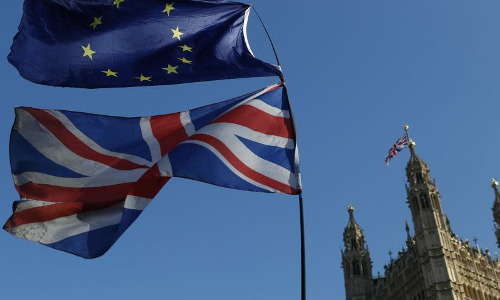 EU and British flags flying over the Palace of Westminster