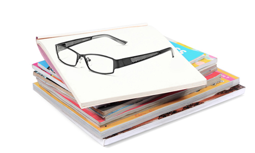 Glasses on a stack of journals