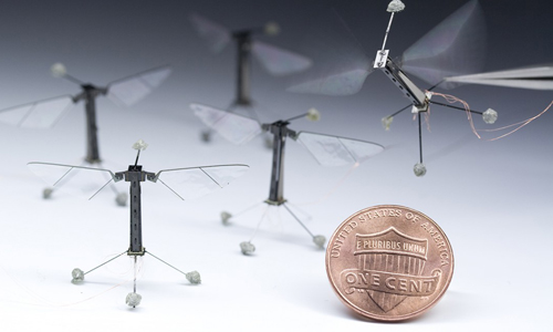 RoboBees with a penny for size comparison