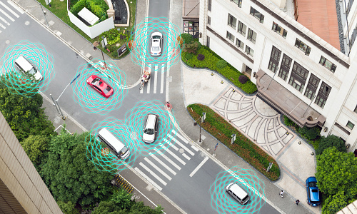 Autonomous cars driving through intersection with illustrated sensors around them