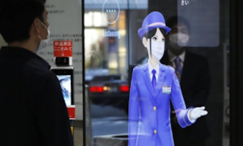 A virtual 'AI guard' displayed on an electric panel welcomes visitors at Ogikubo Hospital in Tokyo.