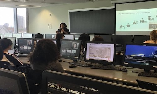 A college computer science classroom full of female students.
