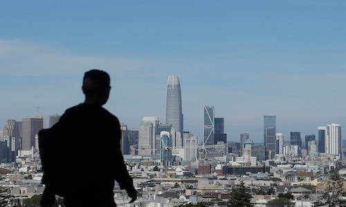 A man overlooking part of the San Francisco skyline, a city where the growth of innovative industries is booming.