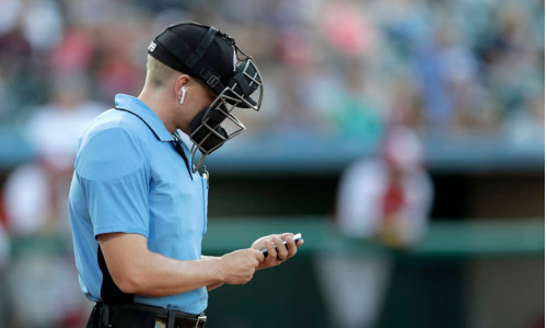 Umpire with airpods on