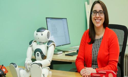 Oregon State researcher Naomi Fitter with standup comic Jon the Robot