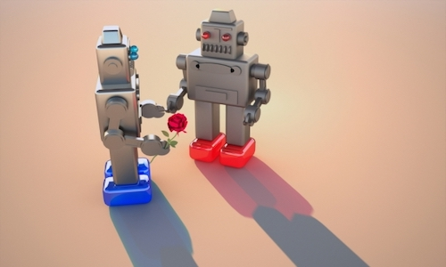 Two toy robots looking like a couple