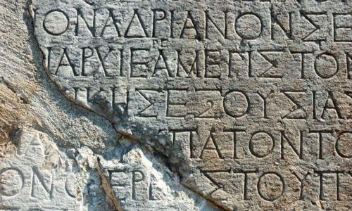 A Greek text inscription on a rock in Delphi