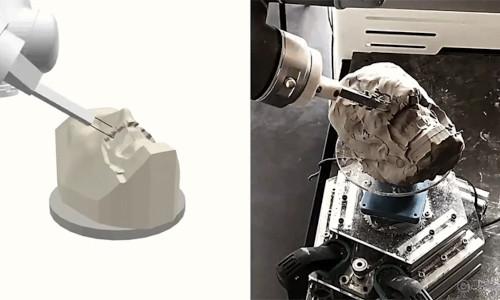 A robot sculpting clay.