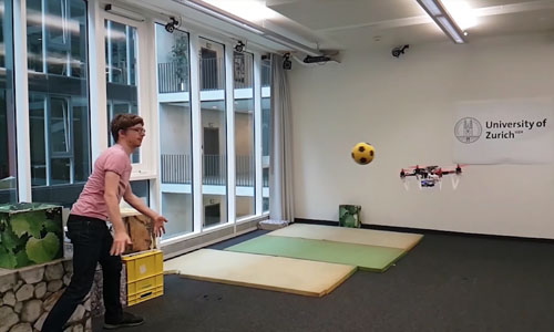 A person throwing a ball at a drone