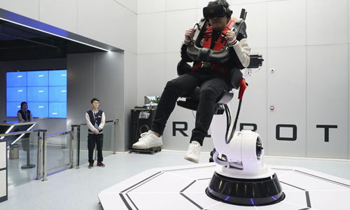 A man on a VR machine, sitting in the middle of the air