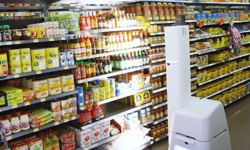 An inventory scanning robot in a market.