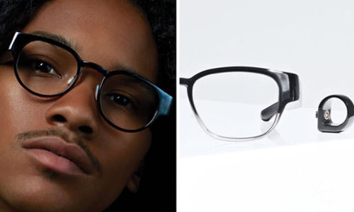 Glasses wth a hidden holographic display the projects images in front of your eyes