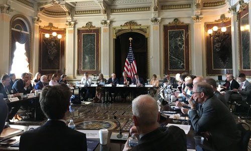 Academics and government officials meeting at the Eisenhower Executive Office Building in Washington