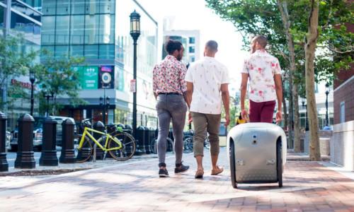 A robot following three guys