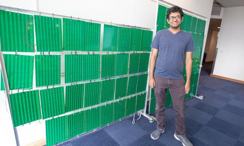 Lead author Venkat Arun in front of the RFocus smart surface prototype.