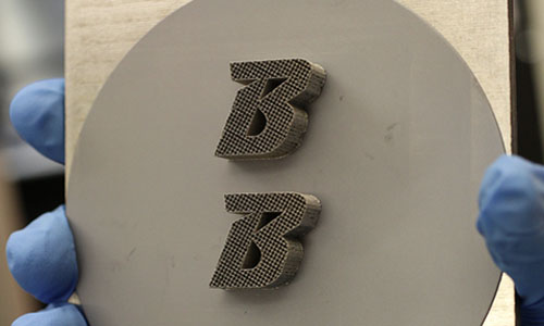 The Binghamton University logo on silicon after printing it with the 3D metal laser printer