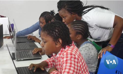 Nigerian girls on laptops