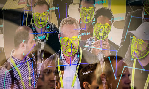 Attendees interacting with a facial recognition demonstration at this year's CES in Las Vegas