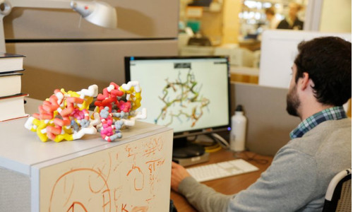 Researcher creating models of molecules