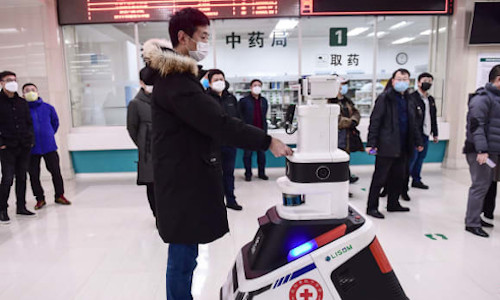 A patrol robot checking temperature and disinfecting people