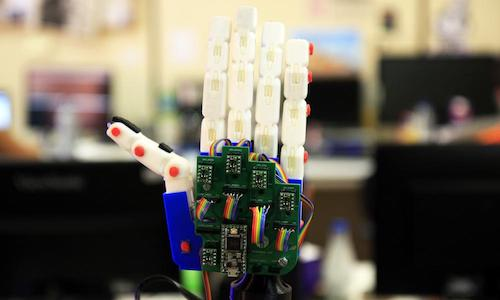 A robotic hand making a gesture in sign language.