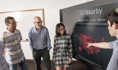Three students and a professor at Carnegie Mellon University