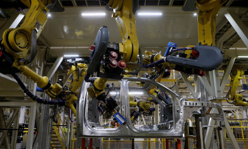 The aluminium cab of all-new 2015 F-150 pick-up truck moves down the robot assembly line at the Ford Rouge Center