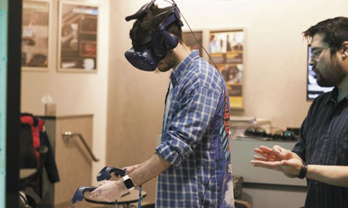 A man trying out a virtual reality headset that stimulates a radioactive spot test