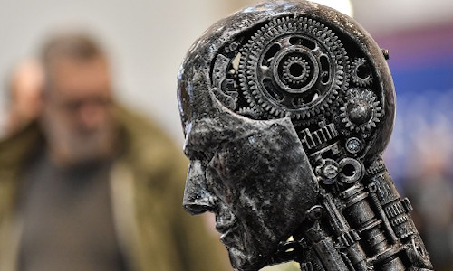 A metal head made of motor parts symbolizes artificial intelligence, or AI, at the Essen Motor Show for tuning and motorsports in Essen