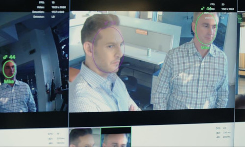Two men's faces getting scanned