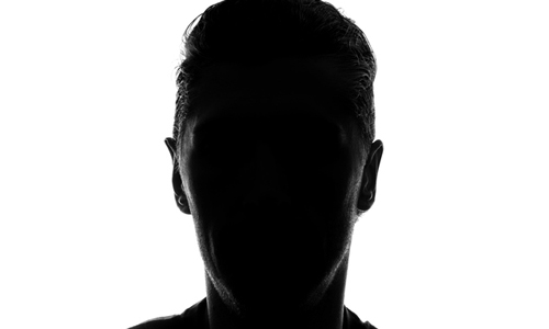 Person with face in shadow
