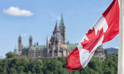 Canadian flag w/ Parliament building in background