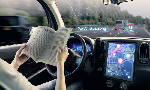 Woman reading in self-driving car