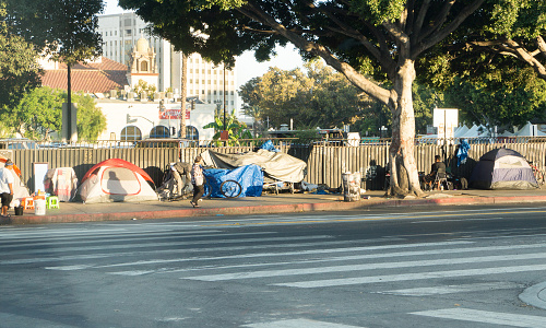 A row of tents and things of homeless people in Downtown LA