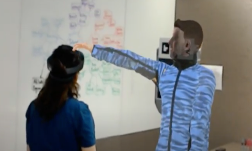 An avatar/telepresence robot in photo depicting Microsoft's Virtual Robot Overlay for Online Meetings.