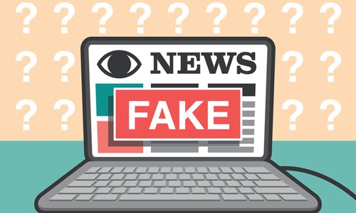 News website on a laptop with fake sign, illustrated