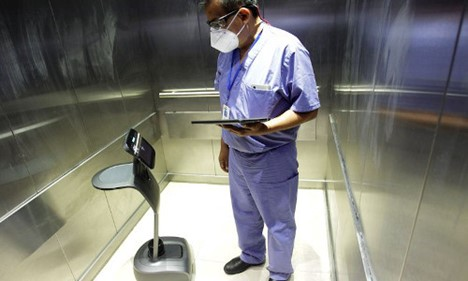 A healthcare worker uses a robot to carry out consultations with patients suffering from the coronavirus at NOVA hospital in Monterrey, Mexico.